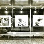 Аэропорту Хельсинки 60 лет,интересная фотовыставка,спящий мужик -неотъемлемая часть инсталяции.