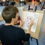 There's a guy here doing FREE caricatures (working off of tips only)