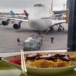 Every time I go to NRT I stop at cafe Avion near gates 22-25 and get a teriyaki chicken and rice bowl. Enjoy the view from the window at the bar!