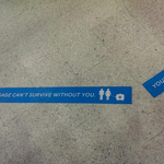Just love the floor stickers in luggage claim.