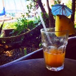 La Marianas Tiki bar is a 6 minute cab ride from the airport. A great waterfront layover or first stop drinking spot. Best tiki dive bar in Hawaii. (HNL airport is in the background.)