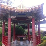 Find a seat at the pagoda in the outdoor garden and relax for a bit between flights.