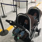 When travelling with twins, no double strollers allowed passed security (because off 3 pieces) solution: bring one separate for each kid.