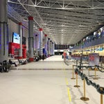 This airport is in high altitude, you will probably feel it by the time you get through customs. Simple airport as to be expected in This part of the world. Staff is very helpful and kind.