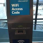 For int'l passengers transiting to/from terminal E: Get your code for free wifi by scanning your boarding pass at the kiosk b/w gate e53 and the Starbucks. This is not widely advertised.