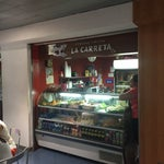 La Carreta is the place to eat (before passing security). Tamale and plantain cost $3 and were delicious.