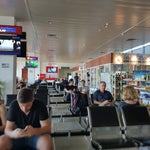 Smaller airport, arrive at last minute for departure, not much to eat/do/shop. Very friendly and efficient service.