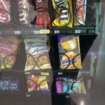 There are Clif Bars in one of the vending machines between the light rail stop and baggage claim. They are $3 but a convenient alternative. :)