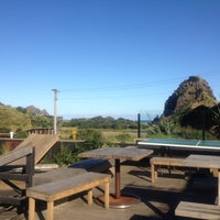 Photo taken at The Piha Cafe by Brook W. on 5/2/2012