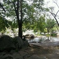 Photo taken at แก่งเกาะใหญ่ @ธารน้ำแม่เรวา by แม๊คคาฟอซ โ. on 4/30/2012