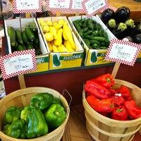 Photo taken at Tom's Farm Market & Greenhouses by Linda E. on 6/30/2012