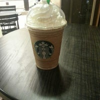 Photo taken at Starbucks by mak on 7/27/2012