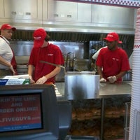 Photo taken at Five Guys by Krystle E. on 7/29/2012