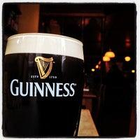 Photo taken at John Mullins Irish Pub by Roel C. on 7/21/2012