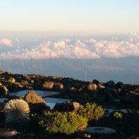 Photo taken at Pu'u 'ula'ula (Haleakalā Summit) by Eunjung C. on 7/27/2012