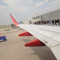 Photo taken at Awaiting Takeoff by Jenny H. on 5/5/2012