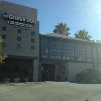 Photo taken at Green Jug Fine Wine & Spirits by Dom D. on 8/12/2012