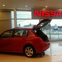 Photo taken at Nissan Grand Brasil by Mari T. on 2/11/2012