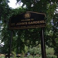 Photo taken at St John's Gardens by Vinh D. on 7/24/2012
