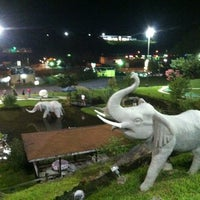 Photo taken at Tropical Gardens Putt Putt by Carolyn E. on 8/13/2012