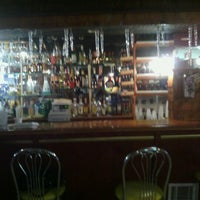 Photo taken at Dazzles Restaurant and Bar Lounge by Stringer B. on 5/15/2012