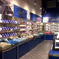 Photo taken at Lindt Maître Chocolatier by Marina C. on 9/3/2012