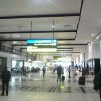Photo taken at International Departures by Ben S. on 3/5/2012