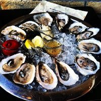 Photo taken at Henlopen City Oyster House by Brian S. on 8/3/2012