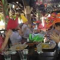 Photo taken at Mulatas by Sara O. on 7/31/2012