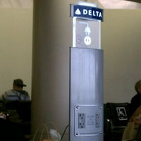 Photo taken at Gate 54A by Lauren M. on 3/12/2012