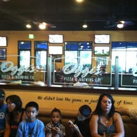 Photo taken at Oggi's Pizza & Brewing Company by Frank G. on 7/22/2012