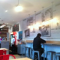 Photo taken at F. Ottomanelli Burgers and Belgian Fries by Esther on 2/24/2012