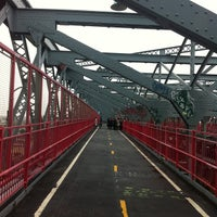 Photo taken at Williamsburg Bridge Pedestrian & Bike Path by Miki E. on 5/24/2012