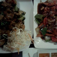Photo taken at Cozy Thai Bistro by Joey L. on 2/18/2012