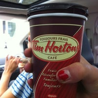 Photo taken at Tim Hortons by Emma on 7/20/2012