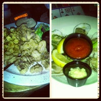 Photo taken at Shucks Tavern & Oyster Bar - Flamingo Rd by Stephanie Y. on 9/5/2012
