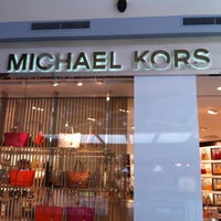 Photo taken at Michael Kors by Erin D. on 6/15/2012