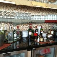 Photo taken at Wingtips Lounge by Selena R. on 5/16/2012