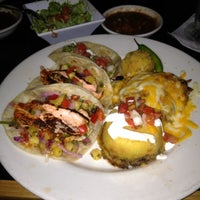 Photo taken at Blue Mesa Grill by Carrie G. on 8/25/2012
