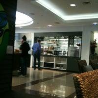 Photo taken at Air New Zealand Koru Lounge by Demet P. on 4/16/2012