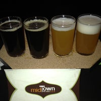 Photo taken at Midtown Wine Bar by Guy J. on 2/25/2012