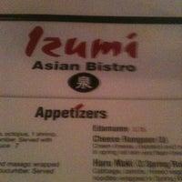 Photo taken at Izumi Asian Bistro by Kathleen T. on 3/4/2012