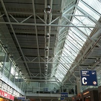Photo taken at Gate C04 by Oleg B. on 6/21/2012