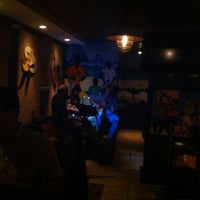 Photo taken at Favela Grill by Marc L. on 2/26/2012
