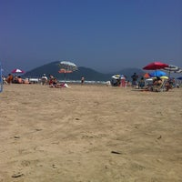 Photo taken at Praia do Sesc Bertioga by Marina Q. on 9/8/2012