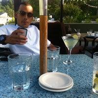 Photo taken at Al Lago Restaurant by Rebecca G. on 7/25/2011