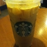 Photo taken at Starbucks by E B. on 5/4/2012
