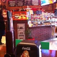 Photo taken at Planet Café by Eva P. on 11/22/2011