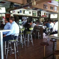 Photo taken at La Deportiva Charlie's Bar by memex on 3/28/2012