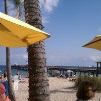 Photo taken at Aruba Beach Cafe by Tiffany W. on 12/29/2011